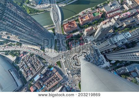 High buildings, river and office area in big city, top view at sunny day in Tianjin, China