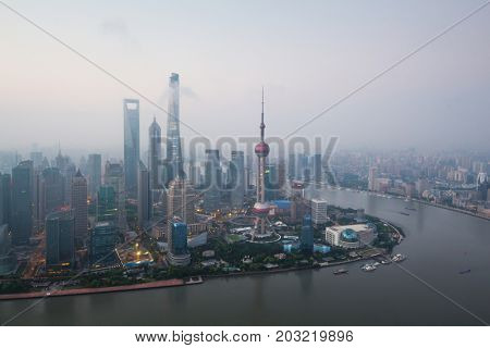 Shanghai pudong lujiazui skyscrapers at morning in fog, top view