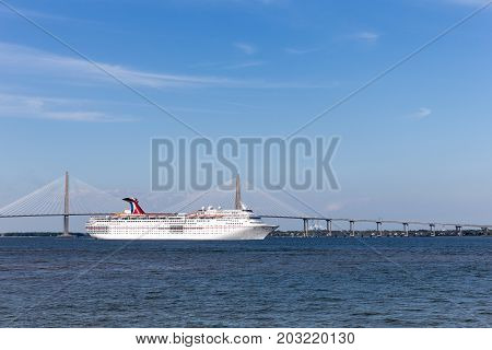 Charleston SC - March 29 2017: Cruise ship leaving historic Charleston SC. The Carnival Ecstasy received a major renovation in 2017. The ship sails to the Bahamas Bermuda and the Caribbean.