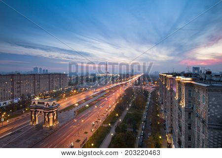 Arch of Triumph with illumination and Poklonnaya Hill Memorial at evening in Moscow, Russia