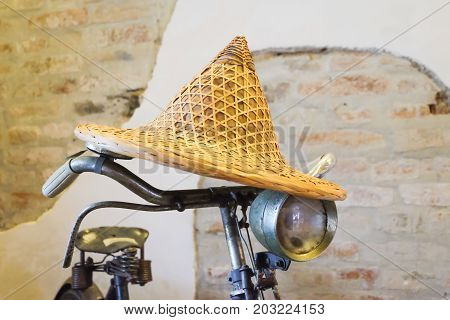 Detail of a vintage handlebar of bicycle with yellow hat weave.