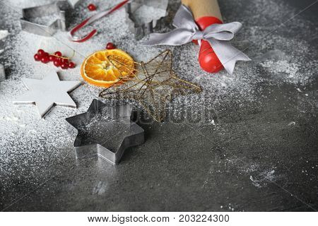 Composition with cookie cutter for Christmas sweets on table