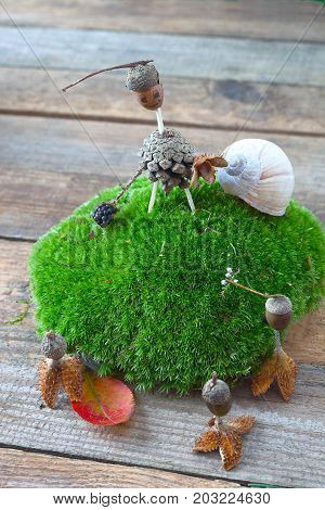 Funny creature made of acorn and pine cone. Craft for children.