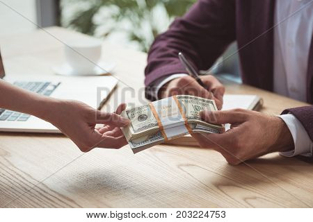 Businesspeople With Dollar Banknotes