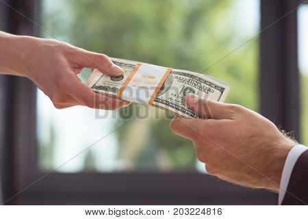 Businesspeople Holding Dollars