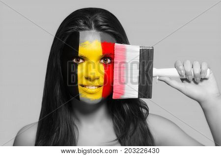 Female supporter in national colors of Belgium