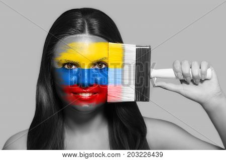 Female supporter in national colors of Colombia