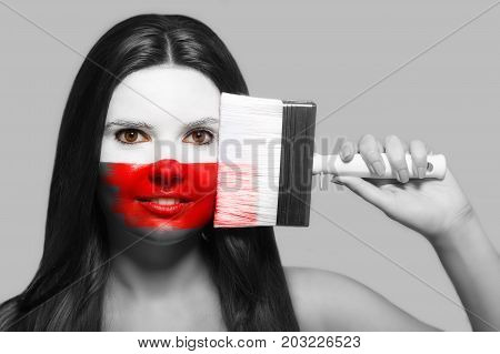 Female supporter in national colors of Poland