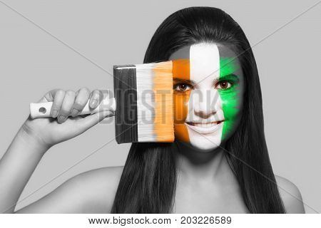 Female supporter in the national colors of Côte d'Ivoire