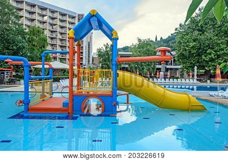 ALBENA BULGARIA - JUNE 16 2017: Colored water tube slide blue pool entertaiment sports close up