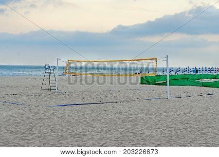 Beach Volley Net Near Sea Blue Water, Field Close Up