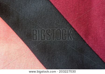 Pink And Red Stockinette Fabric With Black Diagonal Stripe