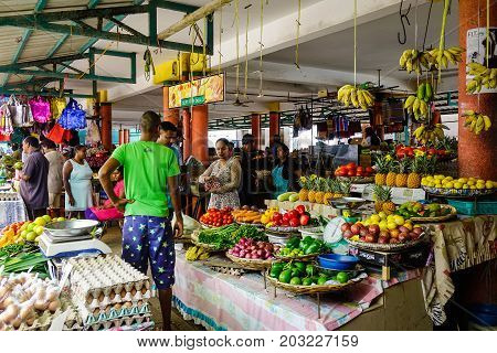 Selling Fruits And Vegetables At A Local Market