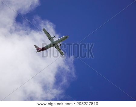 An Airplane Flying In The Sky
