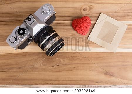 camera vintage and picture frame paperred heart pace on wood backgroundLove valentine vintage.