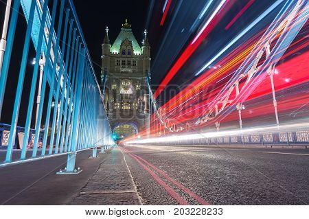 Traffic light trails along Tower Bridge in London. UK