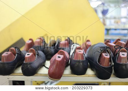 MOSCOW - FEB 21, 2017: Male black leather shoes with plastic shoetree inRalf Ringer shoes factory. For the production of shoes Ralph Ringer use only genuine leather