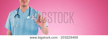Surgeon pretending to be using futuristic digital screen against pink background