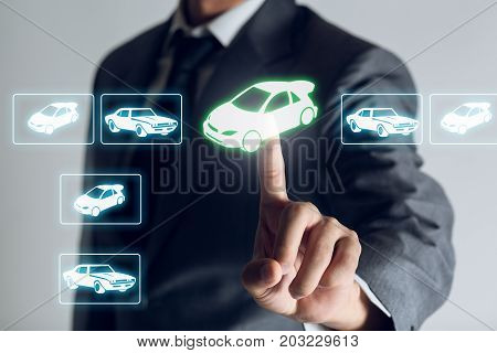 Businessman is shopping online to choose a cars to buy about internet of thing concept Business background.