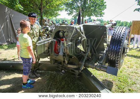 ZAGREB CROATIA - MAY 28 2017 : A soldier shows the boy howitzer 122mm D-30 at the 26th anniversary of the formation of the Croatian Armed Forces on Lake Jarun in Zagreb Croatia.