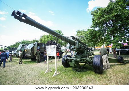 ZAGREB CROATIA - MAY 28 2017 : People sightseeing Howitzer 155 mm M1H1 exposed on the 26th anniversary of the formation of the Croatian Armed Forces on Lake Jarun in Zagreb Croatia.