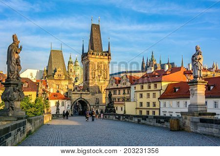 Prague's main sights at dawn: Lesser Town Bridge Towers on Charles Bridge and Prague castel. Czech Republic, Bohemia