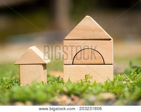 Big wooden home and small wooden home on grass. Home loan or building home or family concept. Home in nature.