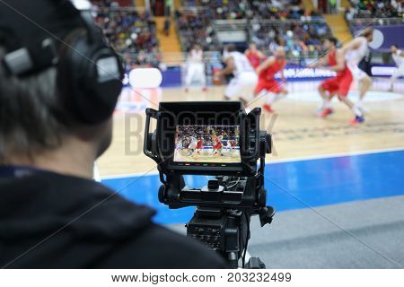 MOSCOW - JAN 27, 2017: Cameraman (out of focus) and camera display at basketball match CSKA (Moscow) - Anadolu Efes (Istanbul) in Megasport stadium