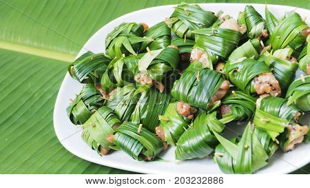 Chicken wrapped pandan raw for fried Thai food background is banana leaf Nice shot of nature concept idea of green to save world has copy space.
