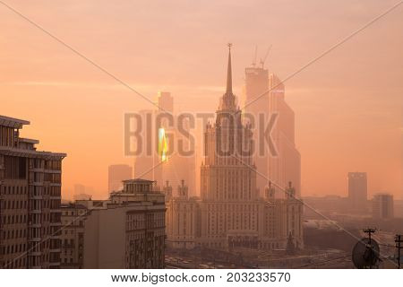 MOSCOW - NOV 29, 2014: Ukraine hotel (Stalin skyscraper) and Moscow International Business Center skyscrapers in fog at morning