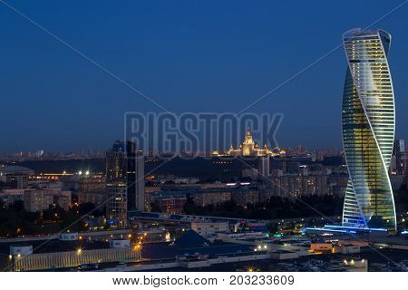 MOSCOW, RUSSIA - JUN 13, 2016: Evolution tower of Moscow City business complex and panorama of city. Moscow International Business Center Moscow City includes 20 futuristic buildings
