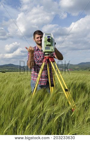 Total station Wheat field Engineer Surveyor Geodesy