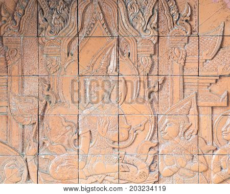 Low embossed stucco on the tiles which decorated around the church in Thai temple.