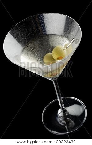 High angle view of a martini with olives isolated on a black background