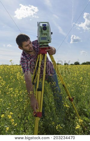 Young Man Surveyor Rapeseed Geodesy Field Work