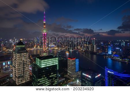 SHANGHAI - AUG 13, 2015: Oriental towe among tall buildings at evening, Oriental tower has height 468 m (1,535 feet), it was the tallest structure in China from 1994â??2007