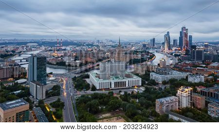 MOSCOW - JUN 10, 2016: Government Building, Ukraine hotel and Moskva river at overcast day