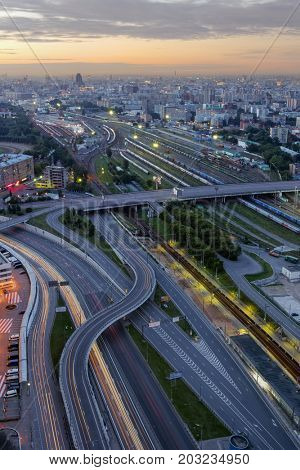 MOSCOW - JUL 24, 2015: Railway and highway at night, view from house on Begovaya st. Russian Railways is among three largest transport companies in world