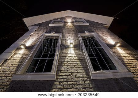 VASILYEVSKOYE, MOSCOW REGION, RUSSIA - FEB 4, 2017: Facade of guest house made of bricks in evening, low angle view, Provence-Hotel Four Seasons.