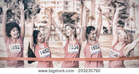 Cheering women supporting breast cancer marathon in parkland