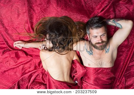 Man And Woman With Half Covered Bodies Lie Together