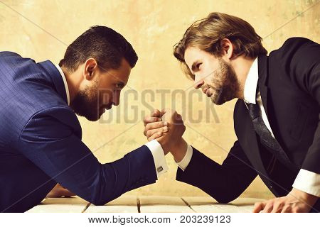 Partnership And Teamwork, Arm Wrestling Of Businessman And Compete Man