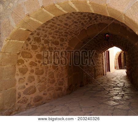 Semi-dark passage with a stone arched vault in the monastery of St. Catherine Sinai (one of the oldest working Christian monasteries in the world) without people.