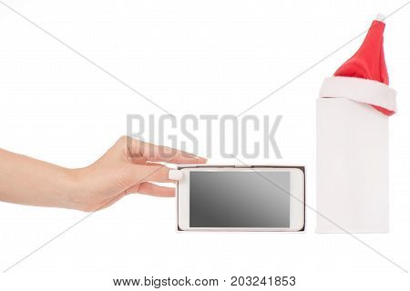 Female hand holding a mobile phone smartphone box Santa hat frost gift on a white background isilation
