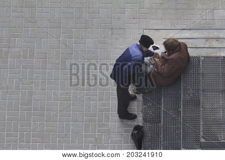 Two beggars near orthodox church in Russia, top view