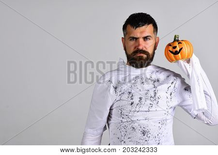 Man With Strict Face Expression Isolated On Grey Background