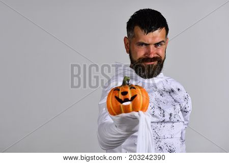 Halloween Character In White Ghost Costume. Man With Tricky Smile