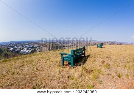 Chairs overlooking birds-eye of Pinetown westmead Industrial park alonside Marianhil N2 toll highway