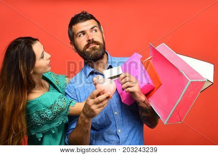 Couple In Love Holds Shopping Bags On Coral Background