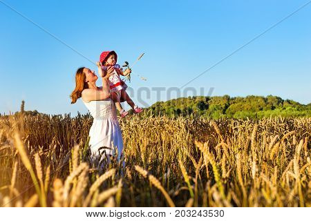 Woman And Child In Golden Ears Grain Crops Field